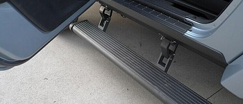 Photo of a 4 Door Electronic Rock Sliders Side Steps With Blue LED Under Lights