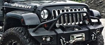 Photo of a Fab Fours Lifestyle Front Winch Bumper With Grill Guard And 1